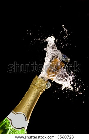 Close-up of explosion of champagne bottle cork #3560723