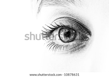 Close-up of eye and face in black and white. Shallow DOF.