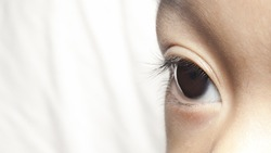 Close up of eye of a child with copy space