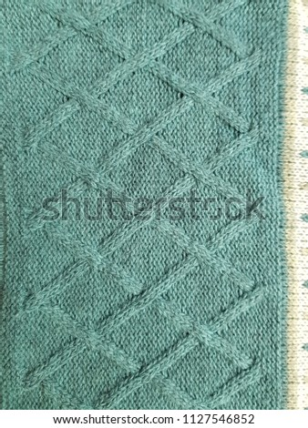 Close up of fabric knitting pattern cotton rhombus texture background #1127546852