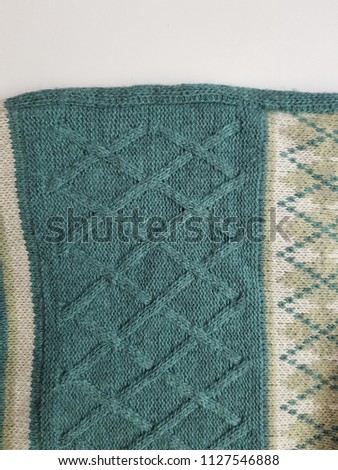 Close up of fabric knitting pattern cotton rhombus texture background #1127546888