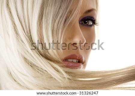 close_up of face of pretty girl with long blond hair watching in camera