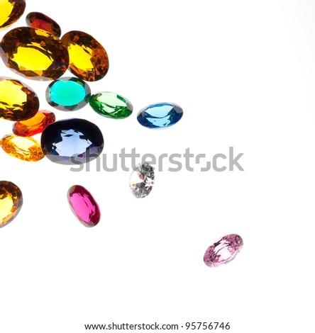close up of falling gems isolated on white background