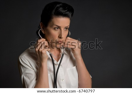 Close-up of female doctor listening during medical exam