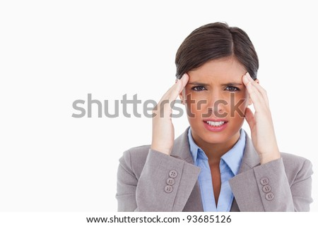 Close up of female entrepreneur experiencing a headache against a white background