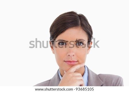 Close up of female entrepreneur in thinkers pose against a white background