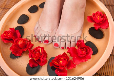 Close-up Of Female Feet Getting Spa Aroma Therapy