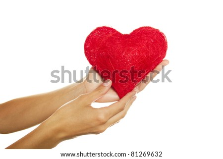 Close-up of female hand holding a red heart. Isolated on a white background