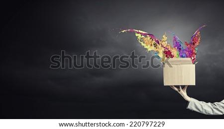 Close up of female hand holding carton box
