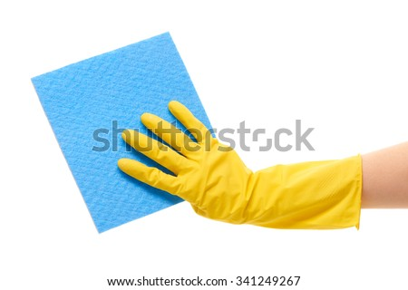 Close up of female hand in yellow protective rubber glove holding blue rag against white background