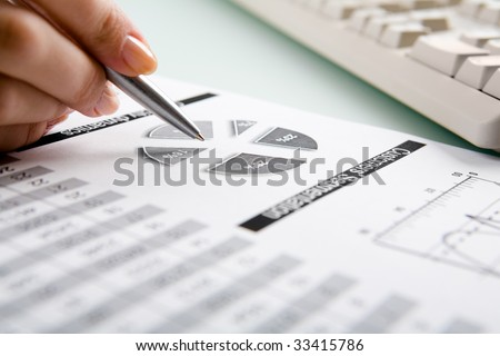 Close-up of female hand making note in business-plan