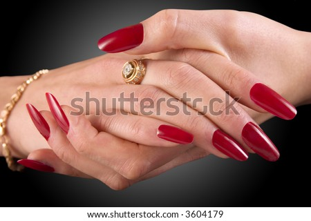 Close-up of female hands on a black background