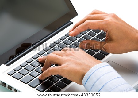 Close-up of female hands over keyboard of laptop during computer work
