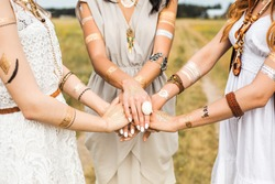 Close-up of female hands, three girls, best friends, flash tattoo, accessories, Bohemian, bo-ho style, indie hippie, ring, bracelet, manicure, feathers