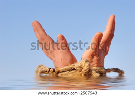 Close up of female hands tied in a rope on the sea (concept for slave or cast-away theme)