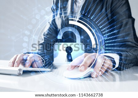 Close up of female hands using computer keyboard and lock icon on screen