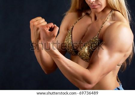 Close-up of female muscular trunk in bikini