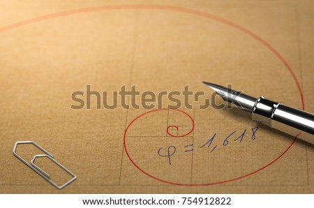 Close up of Fibonacci spiral over paper background with office supplies. Concept of golden ratio. 3D illustration