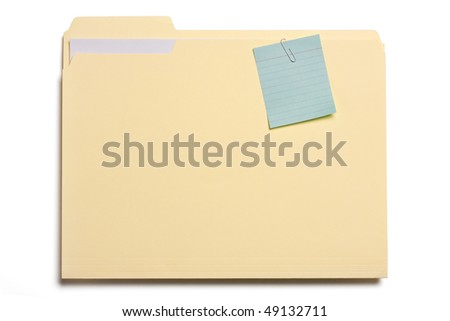Close up of file folder with blue note pad clipped on it.