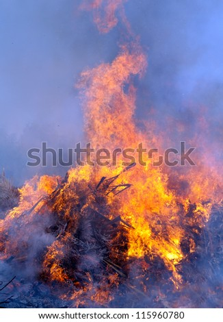 Close-up of fire and flames (human silhouette)