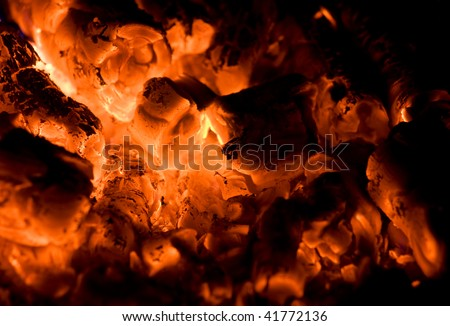 Close up of fire and glow in a fire place