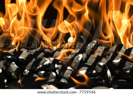 close up of fire burning in a grill