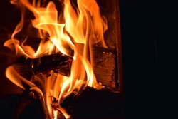 Close up of fire. Logs burning in sauna stove.
