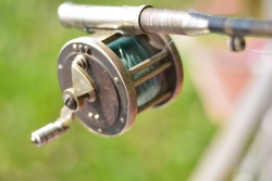 Close up of fishing rod wheel gear, selective focusing
