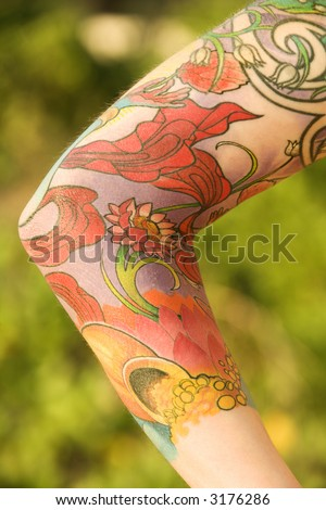 stock photo Close up of floral tattoo on arm of Caucasian woman