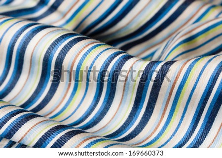 Close up of folded striped material with shallow depth of field