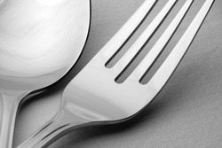 Close-up of fork and spoon on the table