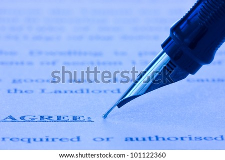 close-up of fountain pen and printed agreement