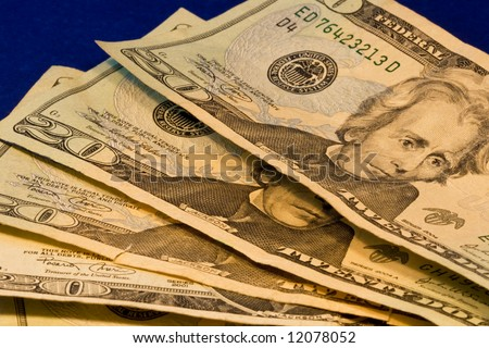 Close up of four american twenty dollar bills showing Andrew Jackson