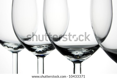 Close up of four glasses of wine on white background