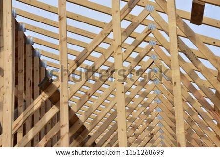 Close up of framework supporting roof of wood frame home.
