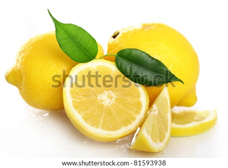 Close up of fresh and wet lemons isolated on white background