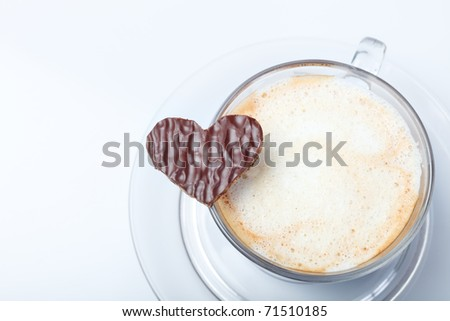 Close up of fresh aromatic coffee and heart shaped cookie