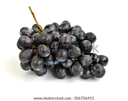 Close up of fresh black grapes isolated on white background, selective focus. #306706415