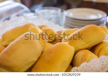 Close-up of fresh bread and dishes in the background #1052829239