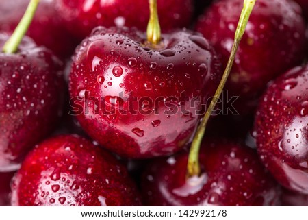Close up of fresh cherry berries with water drops. #142992178