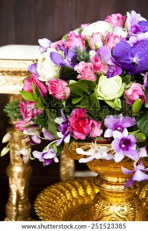 close-up of fresh flowers,  beautiful romantic bouquet for Valentine\'s Day. Holidays and  marriage celebrations decorate in golden vase