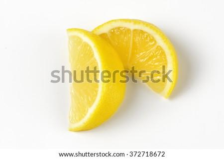 close up of fresh lemon slices on white background