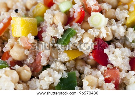 Close up of fresh quinoa salad with bell peppers and chickpeas.