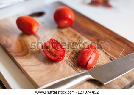 Close up of fresh sliced tomato on wooden board