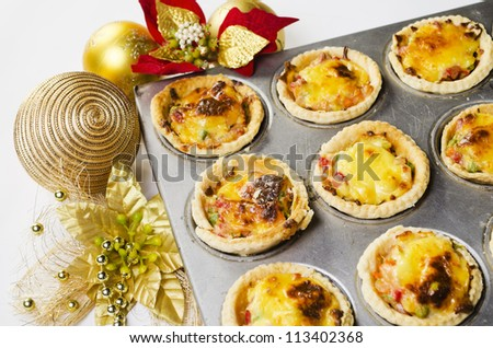 Close up of freshly baked Christmas vegetable and cheese tart