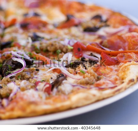 Close up of freshly baked gourmet thin crust pizza