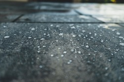 close up of freshly laid concrete pavement with drops of water on ist surface