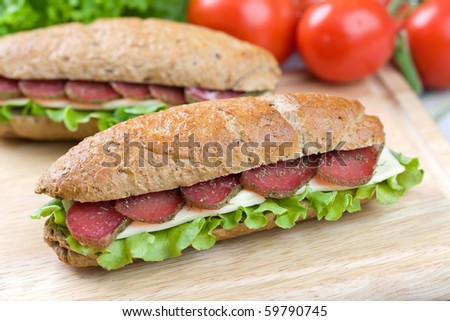 Close up of freshly made sandwich on wooden cutting board