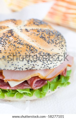 Close up of freshly made sandwich with lettuce, cheese and meat