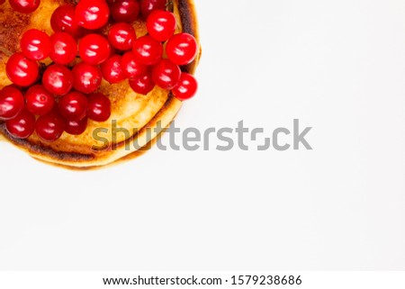 close-up of fried Pancake with red berries isolated on a white background, copy space with copy space, breakfast pancakes, flat lay